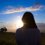 Happy young woman. Beautiful young woman looking out over Hawaiian sunset royalty free stock photo