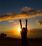Happy young woman. Beautiful young woman looking out over Hawaiian sunset Royalty Free Stock Photos