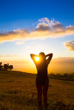 Happy young woman. Beautiful young woman looking out over Hawaiian sunset royalty free stock images