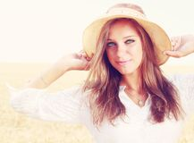 Happy young woman. In golden wheat field Stock Photo