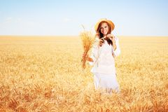 Happy young woman. In golden wheat field Stock Image