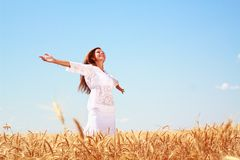 Happy young woman. In golden wheat field Royalty Free Stock Image