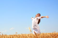 Happy young woman. In golden wheat field Royalty Free Stock Photography