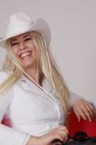 Happy Young Woman. A portrait of a happy young woman in a white cowboy hat royalty free stock images