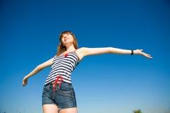 Happy young woman. Enjoying summer Royalty Free Stock Image
