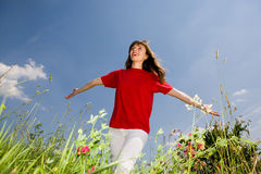 Happy young woman. Smiling under blue sky Stock Image
