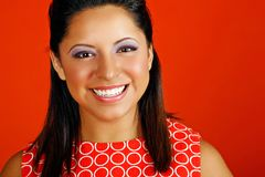 Happy young woman. Pretty hispanic model poses with a big smile Stock Image