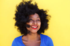 Happy young woman with afro hair smiling. Close up portrait of happy young woman with afro hair smiling stock image