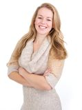 Happy young woman with arms crossed Royalty Free Stock Image