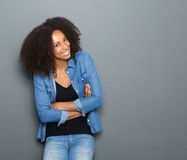 Happy young woman with arms crossed Stock Photo