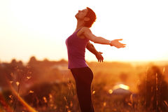 Happy young woman with arms outstretched Stock Image