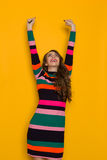 Happy Young Woman With Arms Outstretched Looking Up Stock Photo