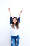 Happy young woman with arms raised up Stock Photography