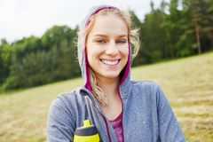 Happy young woman as athlete stock photo