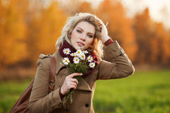 Happy young woman in autumn field Stock Images