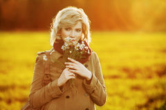 Happy young woman in autumn field Royalty Free Stock Photos