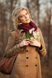 Happy young fashion woman in autumn forest Stock Image