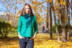 Happy young woman in autumn park Stock Images