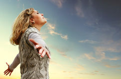 Happy young woman on the autumn sky view Stock Photography