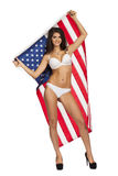Happy young woman on a background of the American flag Stock Photo