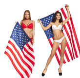 Happy young woman on a background of the American flag Royalty Free Stock Photography