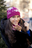 Happy young woman on a background of a winter city Royalty Free Stock Images