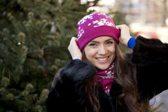 Happy young woman on a background of a winter city Royalty Free Stock Photography
