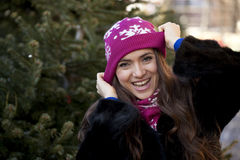Happy young woman on a background of a winter city Royalty Free Stock Photos