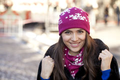 Happy young woman on a background of a winter city Stock Photos