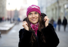 Happy young woman on a background of a winter city Stock Image