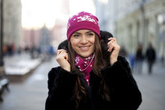 Happy young woman on a background of a winter city Stock Photo