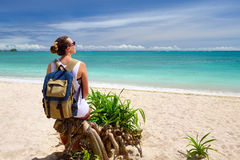 Happy young woman with backpack enjoying view stunning tropical. Happy young traveler with backpack enjoying view stunning tropical beach. Young backpacker stock photo
