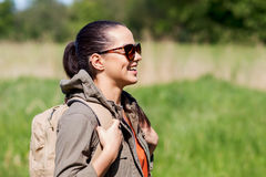 Happy young woman with backpack hiking outdoors Stock Photography
