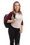 Happy young woman with a backpack looking at the camera Stock Photos