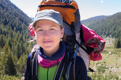 Happy young woman backpacker Royalty Free Stock Photos