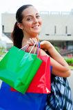 Happy young woman with bags Royalty Free Stock Photography