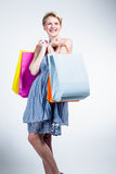 Happy young woman with bags Stock Photography