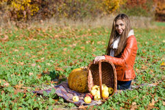 Happy young woman with basket of fresh apples Stock Images