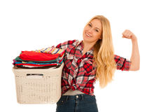 Happy young woman with a basket full of laundry isolated over wh Stock Photography