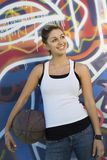 Happy Young Woman With Basketball Royalty Free Stock Photos
