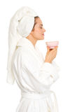 Happy woman in bathrobe enjoying cup of coffee Stock Photos