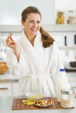 Happy young woman in bathrobe having healthy breakfast Royalty Free Stock Photo