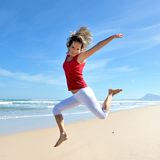 Happy young woman on the beach Royalty Free Stock Photography