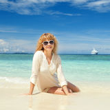 Happy young woman on the beach Stock Photography
