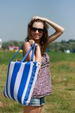 Happy young woman with beach bag Royalty Free Stock Photos