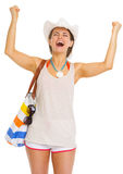 Happy young woman with beach bag rejoicing success Stock Photo