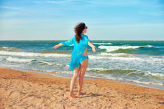 Happy young woman on the beach Royalty Free Stock Photos