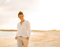 Happy young woman on beach at the evening Royalty Free Stock Photography