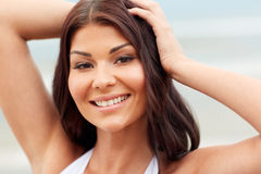 Happy young woman on beach Royalty Free Stock Photos