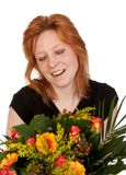Happy young woman with beautiful bunch of flowers Stock Image